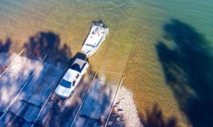 how far to back a boat trailer into water